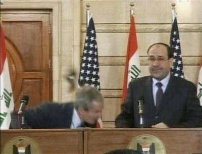 president-bush-gets-shoe-thrown-at-him.jpg