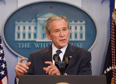 bush-smiliing-with-fingers.jpg