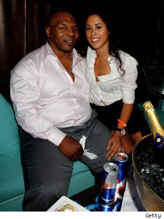 mike-tyson-with-wife.jpg (Is he 5 months pregnant?)