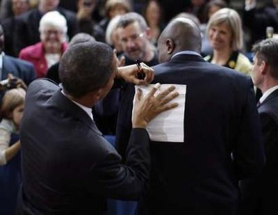 obama-signing-paper-on-back.jpg