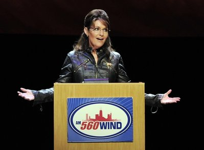 sarah-palin-at-podum-hands-out.jpg