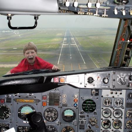 kid-on-hood-of-airplane.jpg