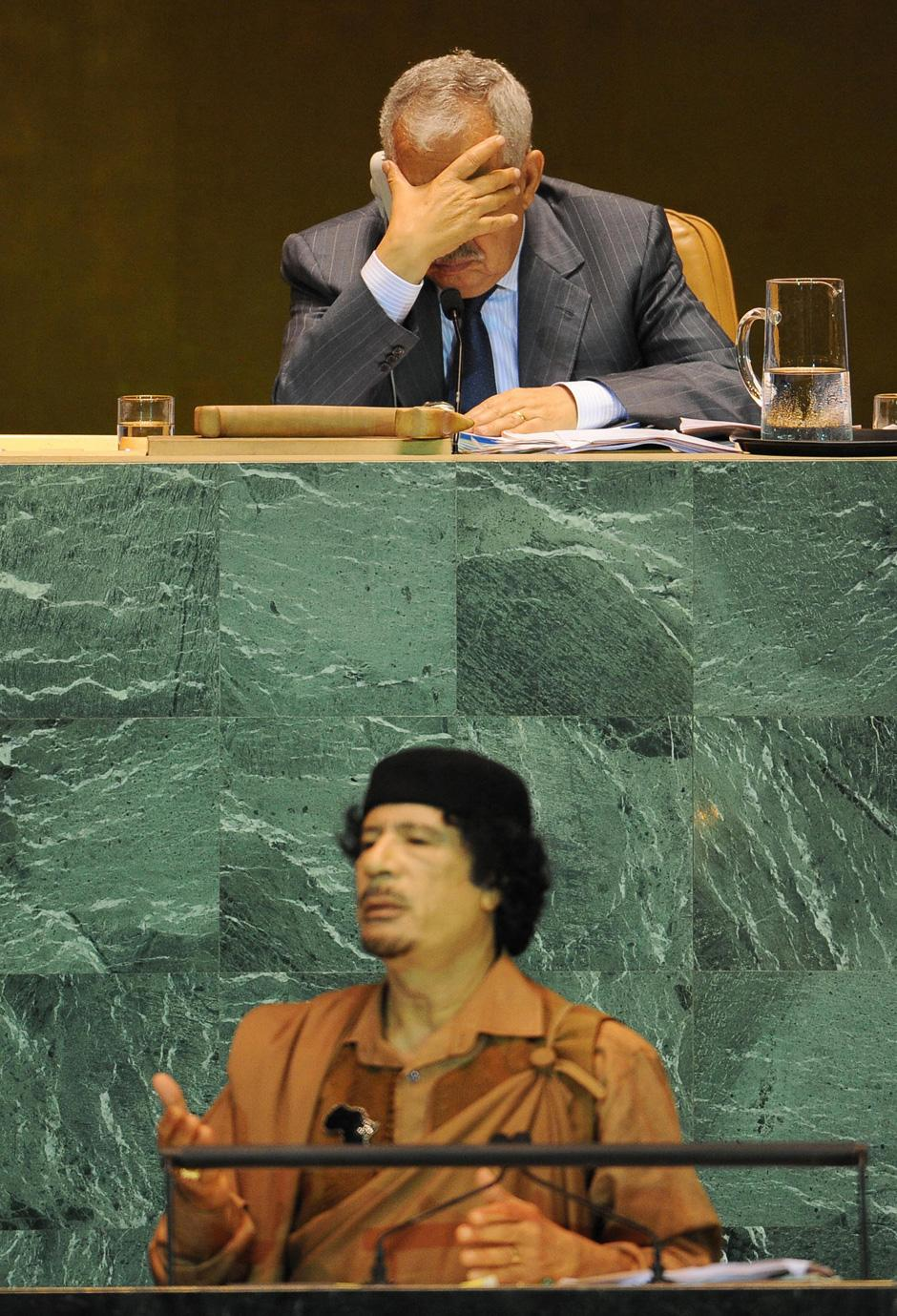 gadhafi-ay-un-with-man-over-him.jpg