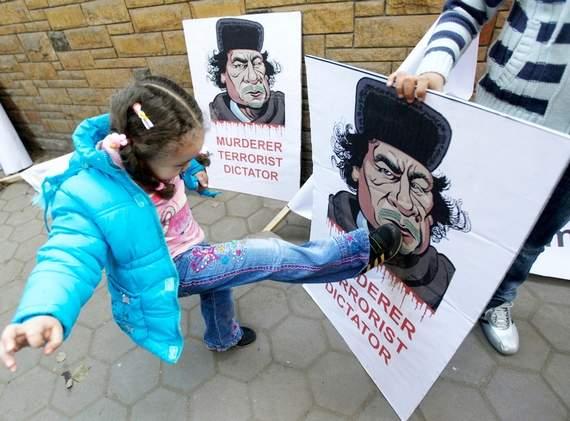 little-girl-kicks-gadhafi-poster.jpg