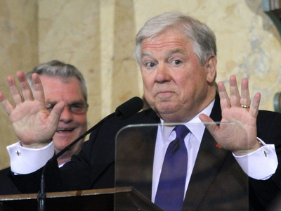 haley-barbour-with-hands-up.jpg