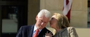 Hillary wispering into Bils ears